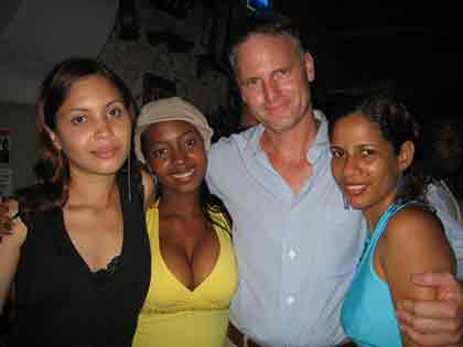 A man with three beautiful Latin women